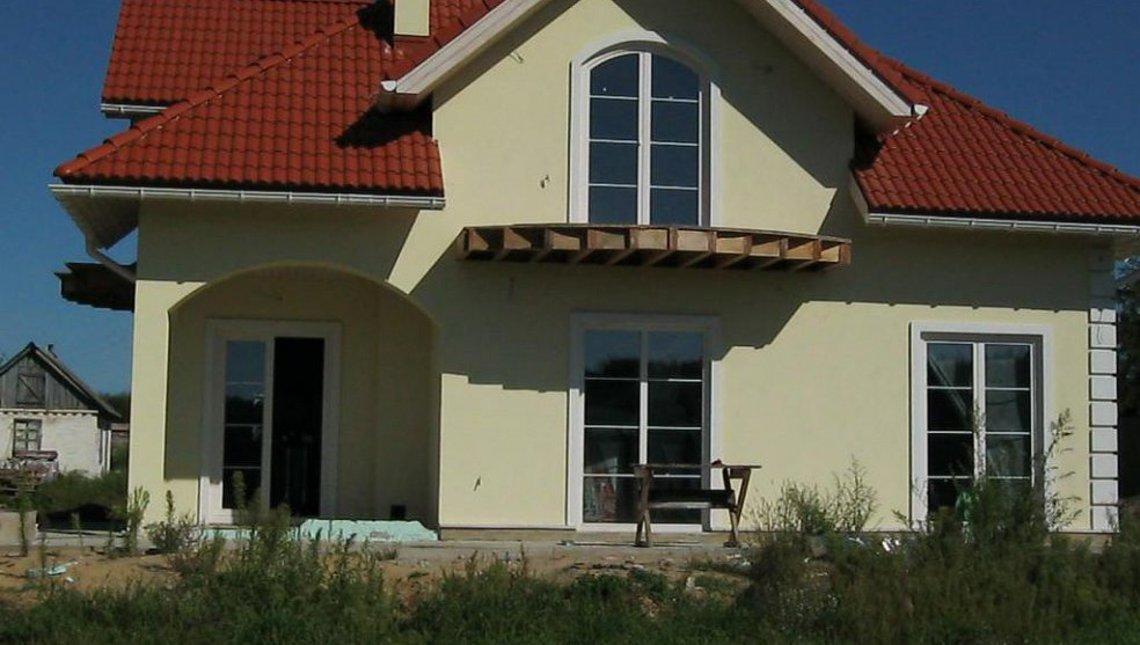 Проект коттеджа с балконами