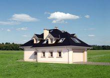 Дом с многоскатной крышей и гаражом для 2х авто