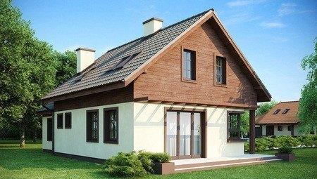 Проект дома с гаражом, красивой мансардой и боковой террасой
