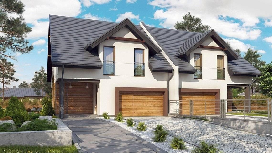 Проект двухэтажного дома на две семьи с гаражом
