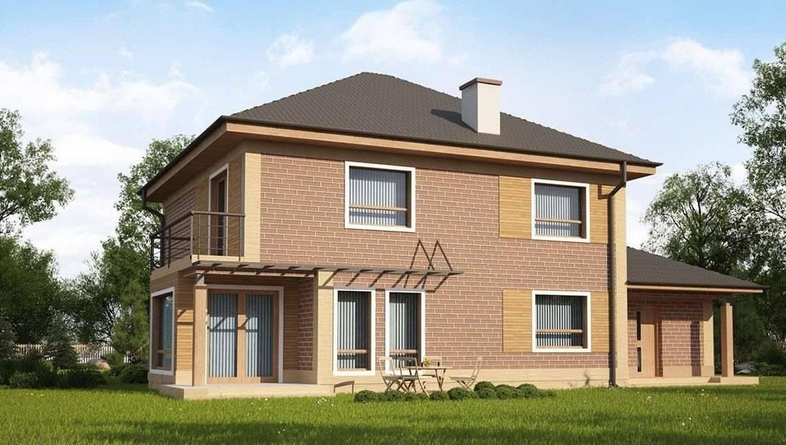 Проект большого двухэтажного дома с гаражом и четырехскатной крышей