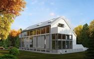 Проект современного наполовину стеклянного коттеджа с гаражом в цоколе