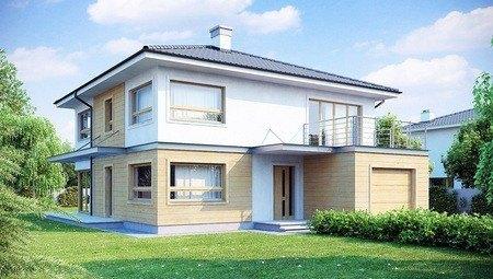 Проект двухэтажного дома с удлиненным гаражом для двух авто